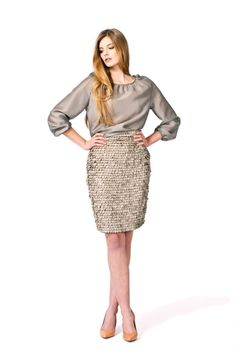 The straight cut and the strong structure of this PLAKINGER Debut Collection handmade faux leather sequins skirt create a modern look. Yet the soft beige color makes the pencil skirt more feminine. byplakinger.com