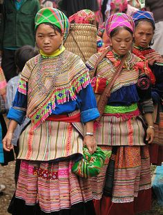 Look at the colours in the clothing of these women, who are Hmong, a group of people from SE Asia who are famed for their textile work, you can see why  File:Hmong women at Coc Ly market, Sapa, Vietnam.jpg