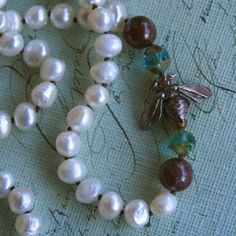 Black knots between pearls