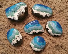Dive right in, the water's fine! Bring home a bit of sun-kissed love with our Beachy Bliss hand painted rocks. Our technique of multi-layer painting will draw you into the depths of the ocean and make