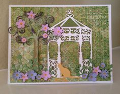 Gazebo:   I used Spellbinders Gazebo die, Impression Obsession tree (DIE036-P) & DIE083-K (cats) plus the McGill Mii Petals.  Then I added touches of Stickles to the flowers.
