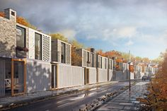 This proposal for a series of dwellings in East London is conceived as a 'miniature terrace'. The site is a narrow strip of land owned by the Peabody Trust, which was previously occupied by garages. The front elevation of each house is split into three...