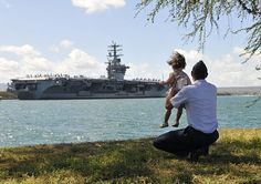 PEARL HARBOR (July 2, 2012) Air force Capt. Jason Coleman and his daughter watch as the Nimitz-class aircraft carrier USS Nimitz (CVN 68) pulls into Joint Base Pearl Harbor-Hickam to support Rim of the Pacific (RIMPAC) 2012 exercise. Twenty-two nations, 42 ships, six submarines, more than 200 aircraft and 25,000 personnel are participating in RIMPAC from June 29 to Aug. 3, in and around the Hawaiian Islands. (U.S. Navy photo by Mass Communication Specialist 2nd Class Jon Dasbach/Released)