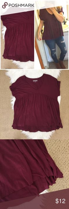 "Mudd Wine Colored Flowy Tee The perfect winter tee! I love the neckline and pleats that fall into a flowy, raw edge hem. Rolled sleeves. ▪️Size Medium ▪️approx 19"" flat across bust and 23"" shoulder to hem. ▪️Rayon/spandex.  In good condition! Mudd Tops Tees - Short Sleeve"