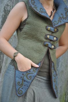 "Hand made women vest ""Fairy pixie"", Woolen tribal vest, Goa girl vest, olive green and gray wear  Hand made girl vest made from Merino wool and linen lining (inside). This is unique and one of the kind vest which is available to purchase.  Size: M (36-38 Eu).  Woman vest closes with hand made metal buttons. Fairy pixie vest has 2 hand decorated pockets, and Flower of LIfe on the back. The Goa vest is very comfortable and suitable to wear on any weather and any occasion."