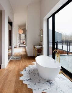 There is something lovely about this bath area. Is it in a hallway - must be a breathtaking view