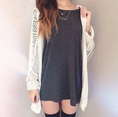 Black thigh highs. Long thin card I sweater or top and necklace simple. Add booties and short shortsor have a long sway sweater dress