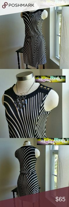 ONE HOUR SALE ...WHBM.GORGEOUS  STRIPE.DRESS ...EXCELLENT CONDITION .... ...LIKE NEW ...NO FLAWS  ...GORGEOUS  ...A MUST HAVEEEEE  ...true to its color... ...color... black / white / bronze gold lining  ...PLEASE READ...SIZE XXS.. ... FITS... SIZE X-SMALL AS WELL. ...2 pic up close ...abstract stripes ..sideways  ...design throughout beautifully  ...bronze gold DECO on shoulders ...pull over style ...comfortable feel ...MTRL...adding soon ...LENGTH. ..adding soon ...better in person White…