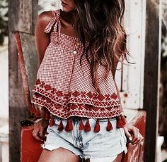 Bohemian inspired top | red boho top with embroidery and tassels | cut off denim shorts | casual beach street style