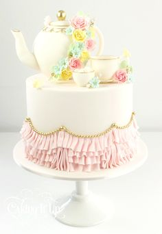 Elegant tea pot and tea cup cake with ruffled tablecloth.  http://www.facebook.com/cakingitup