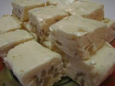 In this video, Betty demonstrates how to make Snowy White Christmas Fudge.  This fudge is really popular around our house during the holiday season!    Ingredients:    3 cups sugar  1 stick (1/2 cup) butter  5-ounce can evaporated milk  7-ounce jar marshmallow crème  1 cup chopped walnuts (I used English walnuts, but you may use pecans, black walnuts, a...
