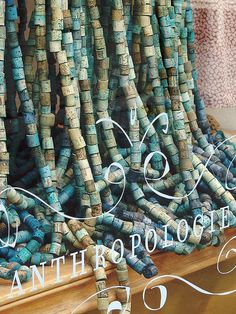 Anthropologie store window repurposed corks as interesting visual display. #retail #merchandising #windowdisplay #repurpose #cork