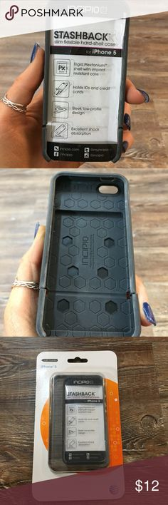 StashBack for IPhone 5! Like New. Black Phone Case This phone case is super fun! It protects your iPhone with a shock-absorbing exterior design and a discreet back panel that hinges open to conveniently store up to three bank cards or cash. It has a slim, compact design with a comfortable soft-touch finish that easily slides into handbags and pockets, eliminating the need for a bulky wallet. *gently used. GREAT condition StashBack Accessories Phone Cases
