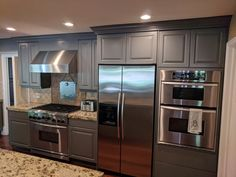 Kitchen cabinets refinished by Chameleon Painting SLC, Utah. Color is Benjamin Moore Amherst gray. Laundry Room Cabinets, Refinish Kitchen Cabinets, Design My Kitchen, Slc Utah, Benjamin Moore, Chameleon, House Ideas, Gray, Pictures