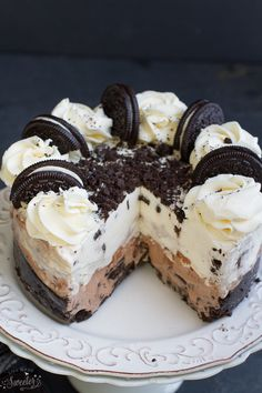 Cookies and Cream Oreo Ice Cream Cake - super easy to make & loaded with chopped Oreos & Tim Tams on an Oreo cookie crust. Perfect for birthdays or any special occasion!