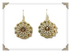 """These earrings are sparkly yet refined and I want to keep them all to myself! This gorgeous pair is made from Czech """"Superduo"""" beads hand woven around a crystal center bead surrounded by sparkling crystal rondelle beads. Shades of topaz mix together with bronze and gold for a complex yet classic look. Measures just a […]"""