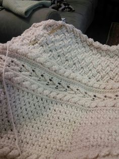 Crocheted cable afghan. Free pattern here: http://www.redheart.com/free-patterns/holiday-cables-throw.
