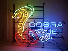 "Finish off your Ford collection with this rare Cobra Jet neon sign. - Sign is 24"" X 17"". - 100% hand-made, gas-filled, real glass tube. - Perfect for clubs, man caves, and home recreation."