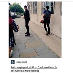 Phil carrying everything so Dan's aesthetic isn't ruined