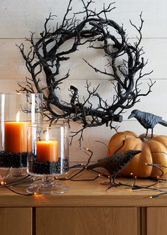 That gnarly looking wreath mad of thick branches would make a nice and slightly spooky-looking Halloween decoration.