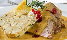 Traditional beef sirloin with cream, not breaded dumplings, cranberries and lemon. Cuisine of Czechia