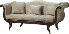 This is an English Regency sofa with a serpentine back and superbly scrolled and tapered arms. The latter with intricate spiral volutes. The apron has a blind fretwork detail of Gothic design. Scimitar legs ending in a brass cap and caster.
