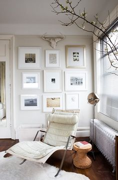 Melanie Acevado via Domino {white eclectic vintage modern living room / nook}   by recent settlers