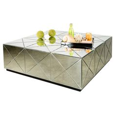 Wood and glass coffee table with mirrored panels and a latticed design.  Product: Coffee tableConstruction Material:...