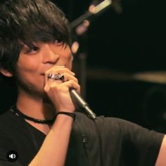 Yamanaka Takuya   THE ORAL CIGARETTES. I love the way he smiles when he's on stage. He's so happy doing what he does