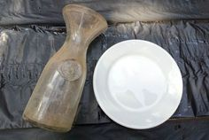 milk bottles plastic plates and a magical toadstool