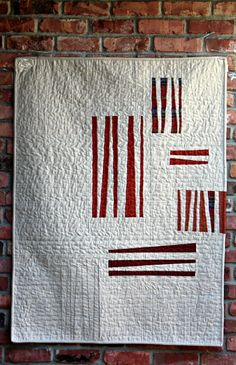 """Debbie from A Quilter's Table made this amusing quilt named """"Sizzle"""" for her 2015 Pantone Quilt Challenge: Marsala . """"For quilting, I did a horizontal serpentine stitch (you know, to replicate the wave of good bacon) using #Aurifil 50wt #2310 (light beige) which nestled into the Robert Kaufman Fabrics Essex nicely while not overpowering the Marsala."""" To see more please visit http://aquilterstable.blogspot.com/2015/03/aka-bacon-quilt.html?showComment=1425306224138"""