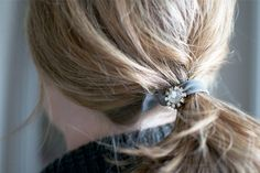 Stitch a thrifted button on your new elastics for a ~schmancier~ feel. | 31 Impossibly Pretty DIY Hair Accessories