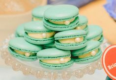 Macaron with a pearl so it looks like a clam. So cute for any water or beach par… Macaron with a pearl so it looks like a clam. So cute for any water or beach party! Mermaid Bridal Showers, Beach Bridal Showers, Mermaid Parties, Pearl Bridal Shower, Party Ideas For Teen Girls, First Birthday Parties, First Birthdays, Birthday Celebration, Lila Party