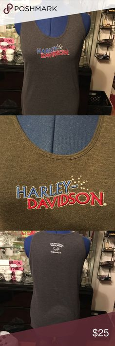 Harley-Davidson top This Harley-Davidson (H-D) top has severThe front states Harley-Davidson and the back has Juneau Avenue; which is Harley-Davidson Corporate Headquarters. Harley-Davidson Tops Tank Tops