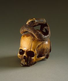 Yes okay I love ese because they remind me of dark marks. I can admit it. | Netsuke: Skull and Snake ,   Second half of the 19th century   Japan  State Hermitage Museum