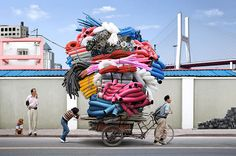 human transport: in Shanghai (photo by Alain Delorme, for The Guardian, UK)
