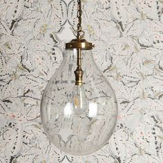 There is a supreme piece of glasswork. Topped with beautiful, buttery brass fittings, it has an almost fluid feel to it and with the right bulb, is just stunning. Glass Pendant Light, Pendant Light Fixtures, Lantern Pendant, Pendant Lighting, Ceiling Pendant, Chandelier, Hall Lighting, Luxury Lighting, Shop Lighting