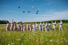 The Wedding Party in a Field of Wild Flowers