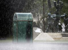 A guard holds his post while dodging the rain underneath a shelter at the Plaza del Servicio a la Patria during a rainy season downpour in Mexico City Friday July 1 2016. The Plaza del Servicio a la Patria acts as an Armed Forces Memorial and was dedicated in 2013. Photo: Nick Wagner [960x709]