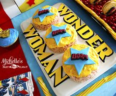rice krispie treats at a wonder woman dessert table Michelle's Party Plan-It: Wonder Woman Dessert Table