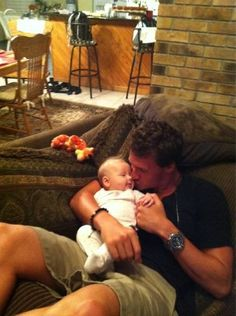 Ryan Lochte with his nephew... which one is cuter? the baby or Ryan?