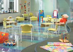 Waiting areas aren't only for adults. Make it fun and comfy for the kids too! This will make parents more relaxed. [Versteel Companion Seating and Odis Tables]
