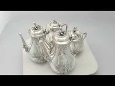 'This magnificent antique American sterling silver four piece coffee set consists of a coffee pot, coffee/hot water pot, covered sugar bowl and hot milk jug...'  http://www.acsilver.co.uk/shop/pc/American-Sterling-Silver-Four-Piece-Coffee-Service-Empire-Style-Antique-Circa-1860-277p8716.htm
