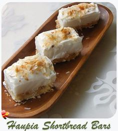 Simply delicious Haupia Shortbread Bars topped with cool whip, shredded coconut and chopped macadamia nuts. Get more island style desserts here.