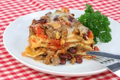 This Mexican Lasagna Has Layers Upon Layers Of Tender, Seasoned Chicken, Spicy Chilies & Of Course At Least Three Different Types Of Cheeses… Some of the most appetizing culinary creations