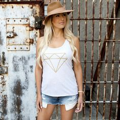 """Our """"Diamond"""" design is on a heather white racerback tank with gold shimmer lettering. Our inspiration is Proverbs 3:15 """"She is more precious than jewels, and nothing you desire can compare with her."""" The scripture reference """"Prov 3   15"""" is embedded in the design on the top left of the diamond."""