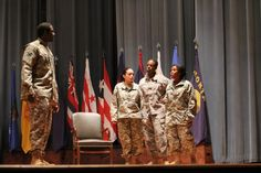 "FORT GORDON, Georgia -- Jeanne Morales (left), Luvenia White (center) and Tunisia Bowen (right) portray Army Soldiers confront their drill sergeant portrayed by Kenneth Bowen (far left) during the performance ""I AM STRONG"" at Alexander Hall, April 18."