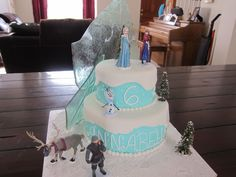 Disney Frozen Cake, Elsa, Anna and other characters, candy ice, blue butter cream, fondant white snow