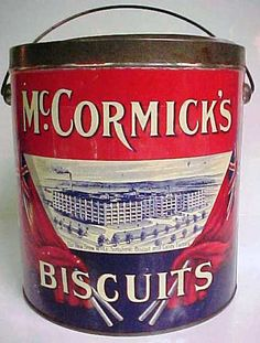 """McCormick's BISCUITS, McCormick's JERSEY CREAM SODAS TIN WITH BAIL HANDLE.Cica 1900. Tin made by McDonald Mfg. Co. Limited Toronto. Measures 7"""" in height X 6 1/2"""" in diameter. Canadian flags draped on either side of """"OUR NEW SNOW WHITE SUNSHINE BISCUIT AND CANDY FACTORY"""" Strong bright colors. Great condition. SOLD!"""