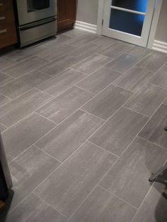 Ceramic Tile Floor Designs ideas and expert tips on ceramic tile kitchen Grey Kitchen Floor, Kitchen Tiles, Gray Kitchen Redo, Kitchen Tiles, New Kitchen, Kitchen Remodel, Kitchen Dining, Grey Tile Floor Kitchen, Kitchen White, Slate Kitchen, Best Floor Tiles